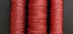 Red threads (Monceau) Tags: red spools metallic twisted threads
