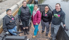 Boat crew ready to clean the river (waterfireprov) Tags: volunteers woodboat