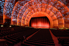 Overture, curtains, lights (DHaug) Tags: nyc red orange newyork architecture snowflakes hall theatre manhattan stage historic curtains fujifilm radiocitymusichall auditorium rockettes looneytunes themesong radiocitychristmasspectacular xt1 indoortheatre xf1024mmf4rois precisiondancecompany bugsbunnyroadrunnerhour