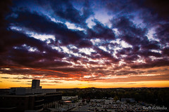 Waukesha Sunset (ReelLifeMedia) Tags: autumn roof sunset sky sun fall cars colors clouds hospital lens landscape evening glow garage parking lot flare waukesha
