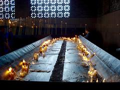 Aparecida - Candles (The Popular Consciousness) Tags: brazil portrait church brasil fire candles catholic cathedral candid smoke prayer flame catholicism offerings sappaulo basilicaofthenationalshrineofourladyofaparecida