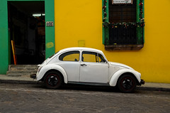 durable engineering (c h r i s t o s) Tags: road street old city colour building classic window car shop stone architecture america volkswagen mexico town store pavement balcony north colonial central beetle historic cobble sidewalk mexican doorway spanish german oaxaca vehicle slanted
