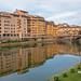 Ponte Vecchio reflecting in the Arno River