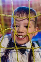 25/365 (goran1101) Tags: boy portrait colors 35mm kid nikon toddler vibrant teeth bowtie rope biting ropes project365 d5100