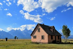 The Pink House (Patricia Henschen) Tags: pink house mountains clouds catchycolors wyoming grandtetons tetons grandtetonnationalpark privy mormonrow