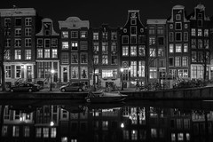 Windows 95 (McQuaide Photography) Tags: old city longexposure nightphotography windows winter light urban blackandwhite bw holland reflection window water netherlands monochrome dutch amsterdam architecture night zeiss photoshop vintage outside mono licht canal blackwhite lowlight europe nacht outdoor sony traditional tripod capital nederland wideangle ramen fullframe alpha residence 16mm residential redlightdistrict oud stad authentic raam rld manfrotto noordholland gracht lightroom oudezijdsvoorburgwal canalhouse wideanglelens capitalcity 1635mm northholland a7ii grachtenpand groothoek variotessar mirrorless sonyzeiss mcquaidephotography ilce7m2