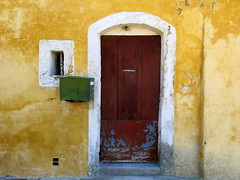 Old doorway with green metal mailbox, Mane, Provence, France (Spencer Means) Tags: architecture house wall door doorway window frame stucco mailbox green metal mane provence france provencealpescotedazur village