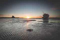 Ripples (Danny Birrell) Tags: morning light sea sun seascape reflection castle beach wet beautiful sunrise canon landscape dawn coast boat sand northumberland tamron tamron1735 canon5dmkii hitech6gradfilter