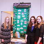 Students pose in front of their project on the Amazon Rain Forest.