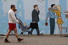 Single, Couple, Family :-) (Wackelaugen) Tags: street man canon painting walking person photography eos photo couple europe walk scene gemany ludwigsburg googlies wackelaugen