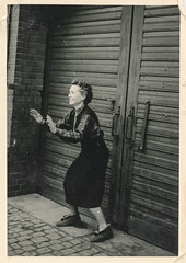 Woman preparing to catch something (simpleinsomnia) Tags: old woman white black monochrome vintage found blackwhite antique snapshot photograph catching vernacular slippers foundphotograph