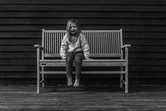 Bench portraits I - bad day (' A r t ') Tags: family people blackandwhite bw monochrome ava bench mono blackwhite toes raw outdoor familie headshot barefoot unhappy famke onesock remoterelease cammelbeeck arthurcammelbeeck artcammelbeeck falcklarsen