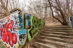 Mondays (CJ Schmit) Tags: trees nature face leaves wall wisconsin stairs canon concrete outdoors graffiti spring log ruins paint westbank branches milwaukee spraypaint railing mondays mke locuststreet milwaukeeriver gordonpark canonef1740mmf40lusm milwaukeecountyparks canon5dmarkiii cjschmit 5dmarkiii wwwcjschmitcom cjschmitphotography gordonparkbathhouse