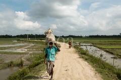 H504_3113 (bandashing) Tags: road street england sky people water field manchester village ditch stuck path walk transport monsoon land remote sylhet bangladesh muddy rains socialdocumentary crude aoa bandashing ratargul