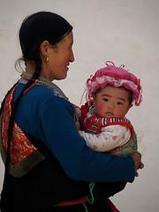 Tibetan woman with her grandoughter, Tongren, Sichuan (magbrinik) Tags: china family kids children religion tibet monastery sichuan pilgrim gansu traditionaldress tibetanbuddhism littletibet tibetanmonastery tibetanculture tibetanfestival childeyes tibetanreligion tibetanchikdren