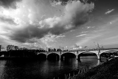 crossing (Tom Anirae) Tags: bridge red sky blackandwhite bw france monochrome seine clouds contrast train river boat nikon angle noiretblanc wide large railway nb ciel filter pont nikkor f28 afd 2035mm officialnikkor d700