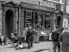 Performance outside a Cafe in York (steve.gombocz) Tags: york blackandwhite music streets noiretblanc streetscene olympus busker streetmusic negroyblanco bwphotos schwartzundweiss omdm5 mzuikodigital25mmf18lens olympusomdm5mark2