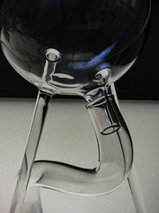 Distillation (Steve Taylor (Photography)) Tags: uk greatbritain blue england black reflection london art glass grey flask shiny unitedkingdom tube gb bent curve distillation monocolor monocolour