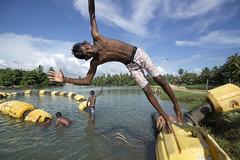 Water fun (Photosightfaces) Tags: playing boys water kids youth swimming fun happy jumping dive young diving lagoon sri lanka srilanka splash srilankan hikkaduwa lankan splashing pictureofsrilanka
