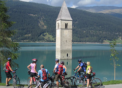 Tower in The Lake (travelnotes) Tags: travel italy mountain lake mountains alps tower tourism church water photography cycling cyclists tirol italian europe european photos pics south transport lakes pass alpine photographs cover transportation michel tyrol sud travelnotes reschen guntern