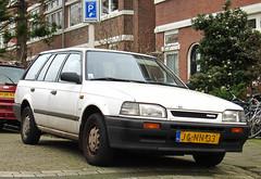 1994 Mazda 323 Estate 1.6i LX (rvandermaar) Tags: familia estate 1994 mazda bf lx 323 16i mazda323 mazdafamilia mazda323bf sidecode5 mazdafamiliabf jgnn33