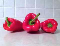 three red peppers (Mr.  Mark) Tags: red food cooking kitchen pepper photo counter stock vegetable tiles markboucher