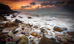 Early days (Glynmoto) Tags: longexposure sunset sea beach water wales rocks pebbles anglesey penmanpoint