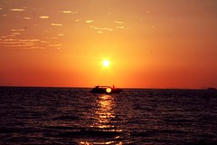 Two sunsets (__Thomas Tassy__) Tags: light sunset shadow red sea sun seascape beautiful canon relax thailand photography eos 350d idea boat photo amazing solitude alone phi atmosphere pic stunning don ley phuket inspire krabi seul
