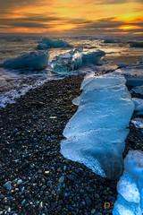 i c y  b e a c h  19016 (Philip Esterle) Tags: winter ice beach clouds sunrise dawn landscapes is iceland skies seascapes shoreline scenic beaches oceans atlanticocean hdr seas jökulsárlón glacial naturephotography waterscapes blacksandbeach landscapephotography austurland blacksands glaciallagoon vatnajökulsþjóðgarður vatnajökullnationalpark pentaxk3 fingolfinphoto philipesterle