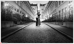 Hamburg Street Romance (lichtfusion.net) Tags: street love monochrome night blackwhite al nikon couple published nightlights nightshot availablelight hamburg romance symmetry story highiso 135mm streetshot girlboy f20 brenizer rothenbaum hamburgcity iso6400 loveshot fashionblog nikond810 multirowpanorama aposonnar1352zf zeissaposonnart2135 sonnar1352zf lichtfusionnet theeuropeanlookde symmetrykiller