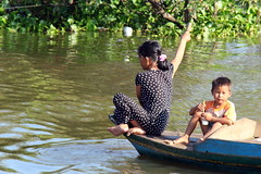 Siem Reap River (asitrac) Tags: travel people nature water rural river countryside boat kid scenery asia cambodia southeastasia village child floating scene transportation tropical rowing kh siemreap navigation motherandchild ecosystem indochina floatingvillage siemreapriver chongkhneas lotic siemreapprovince tonlsap fastmovingwater freshwaterecosystem laketonlsap