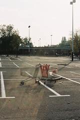 V2 (Safouane Ben Slama) Tags: 2 sun paris film analog 35mm concrete centre parking commercial suburb bitume auchan banlieue parisienne caddie velizy