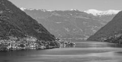 the first sun... (sermatimati) Tags: light shadow sky bw italy panorama sun lake snow como mountains hot cold tourism nature beauty montagne reflections nude lago village bare magic charm tourists spell clean photograph fotografia acqua turismo riflessi bianco lombardia freddo nero glamor photographing boiling turisti magia selfie lombardy bello caldo fotografare fascino
