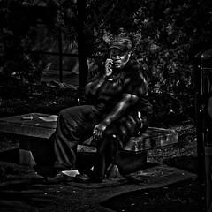 """Serious Phone Call During Smoke Break"", George Washington University Metro Park, Washington, DC (Gerald L. Campbell) Tags: life street bw woman digital washingtondc blackwhite dc citylife streetphotography squareformat spirituality aloneness injustice socialdocumentary indifference alienation blackwoman inequality spiritualindifference socialatomism canong7x georgewashingtonuniversitymetropark"
