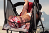 Just chilling (Roving I) Tags: street babies caps flags vietnam diapers netting nappies starsandstripes danang strollers feetup pushchairs barechests