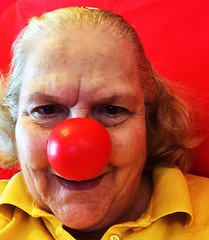 Preparing To Be Rudolph (garlandcannon) Tags: smile rednose oldlady selfie odc redbackground