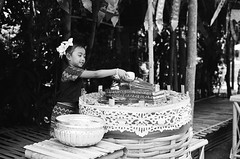 Pouring water over the hands of Buddha (skamalas) Tags: new girl temple child buddhist years wat songkran