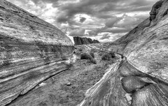 Canyon (magnetic_red) Tags: sky storm mountains clouds sand sandstone rocks desert stripes nevada dramatic canyon wash americanwest arroyo
