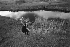 The girl collecting flowers on a river slope for weaving of wreaths (misha maslennikov) Tags: bw film nikon russia don f3 steep senshin maslennikov otherrussia