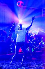 Black-light indoor beach volleyball - serve (rikki480) Tags: blue light black college beach sports club sand uv indiana indoor tournament blacklight flourescent volleyball empowered fortwayne pcc