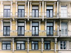 10 met , 5 zonder . (roberke) Tags: old windows yellow hotel belgium westvlaanderen oostende geel oud gebouw reflecties vensters ornamenten