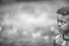 Gaze (mckenziemedia) Tags: boy portrait blackandwhite canon eos bokeh mark iii profile 85mm stare 5d gaze f12