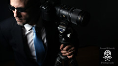(Donald Palansky Photography) Tags: camera selfportrait me sunglasses photographer sony tripod sigma alpha businesscard gitzo strobe suitandtie alienbees meandmycamera creativelighting sigma70200mm strobist donaldpalanskyphotography