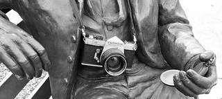 a man... a watch... a camera