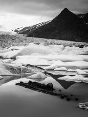 Fjallsrln 02 (arsamie) Tags: winter light white mountain snow black cold reflection ice water contrast dark volcano lava iceland high lagoon glacier fjallsarlon
