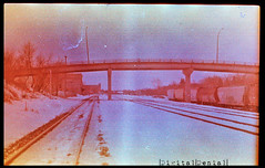 (|Digital|Denial|) Tags: railroad bridge winter sky snow colour analog 35mm crossprocessed traintracks overpass trains slidefilm ektachrome filmgrain expiredfilm traincars colourshift retrochrome