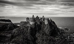 Ruined Dunluce Castle (Trev Bowling) Tags: ireland sea cliff castle rock stone ancient ruins horizon ruin antrim dunluce dunlucecastle nthireland