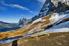 The empty Bench In front of The mighty Eiger , the Wetterhorn & Grindelwald. No. 1455. (Izakigur) Tags: schnee sunset snow alpes bench schweiz switzerland twilight europa europe flickr suisse suiza swiss mother grindelwald nikkor svizzera eiger thelittleprince berneroberland sussa kleinescheidegg wetterhorn suizo grossescheidegg jungfraubahn myswitzerland d700 thelonelybench nikond700 izakigur thejungfrauregion suisia
