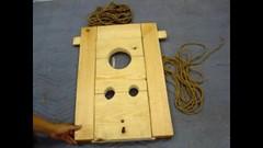 Locked in wodden stock (asiancuffs) Tags: prison shackles handcuffs prisoner handcuffed