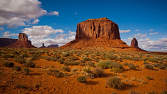 The Mittens and Merrick Butte (Harold Brown) Tags: travel arizona sky usa clouds landscape spring butte desert outdoor redsand canoneos20d monumentvalley twop navajotribalpark haroldbrown bhagavideocom haroldbrowncom photosbhagavideocom harolddashbrowncom